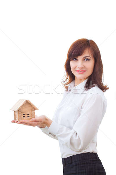 Real estate agent with house model Stock photo © artfotodima