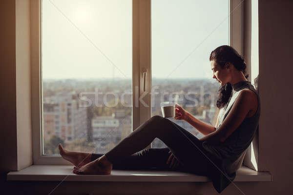 Girl resting and thinking at home Stock photo © artfotodima