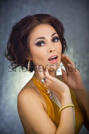 Sexy girl oro abito lucido ritratto bella Foto d'archivio © artfotodima