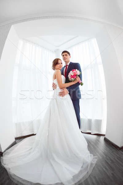 Bride and groom in very bright room at home Stock photo © artfotodima