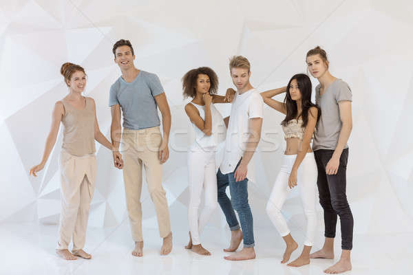 Group of young Multi-ethnic friends indoors in studio Stock photo © artfotodima