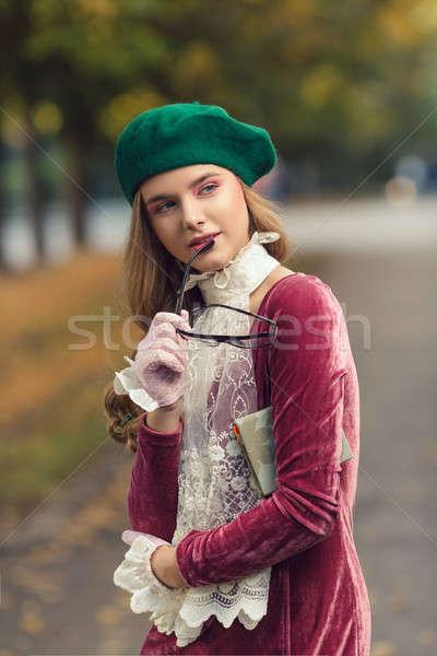Fashion portrait of college student girl at campus outdoors Stock photo © artfotodima
