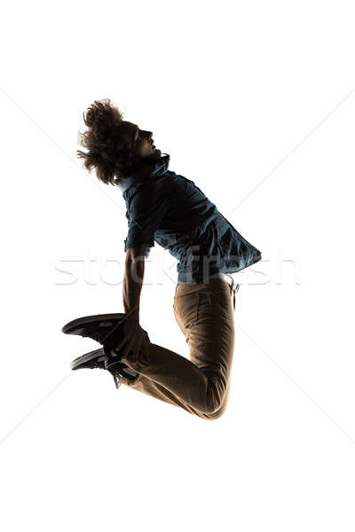 one caucasian young acrobatic break dancer breakdancing man in silhouette white background Stock photo © artfotodima