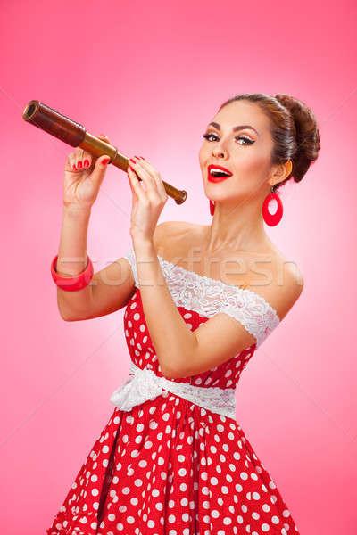 Szczęśliwy kobieta teleskop pinup w stylu retro Zdjęcia stock © artfotodima