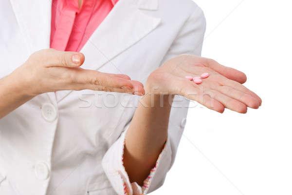 Medicines in hand close-up. Stock photo © artfotodima