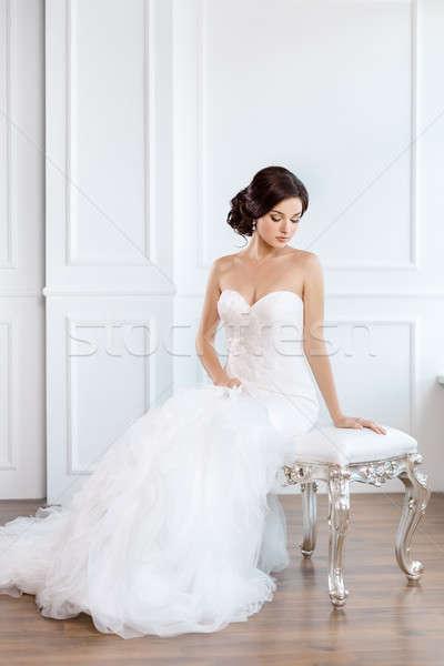 Bride in beautiful dress sitting on chair indoors Stock photo © artfotodima