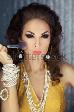 Beautiful face of a glamour woman with smoky eyes make-up. Beauty portrait young girl. Stock photo © artfotodima