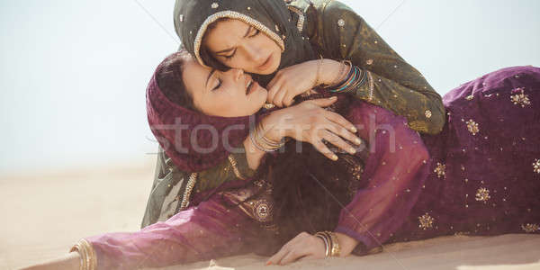 Women thirsty in a desert. Unforeseen circumstances during the travel. Stock photo © artfotodima