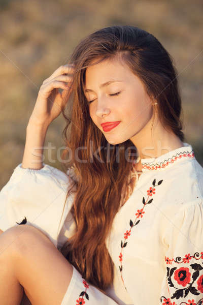 Portrait of beautiful girl in meadow in national suite Stock photo © artfotodima