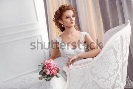 Stunning young bride holding bouquet Stock photo © artfotodima