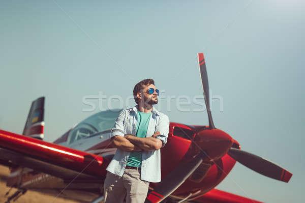Man in front of vintage plane Stock photo © artfotodima
