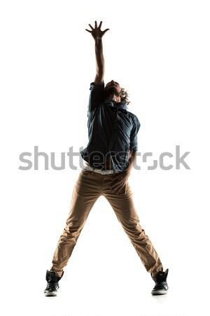 Modern style dancer posing on studio background Stock photo © artfotodima