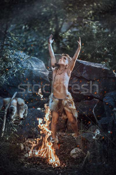 Shamans boy at the fire Stock photo © artfotodima