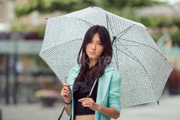 Stock photo: Asian girl city portrait.