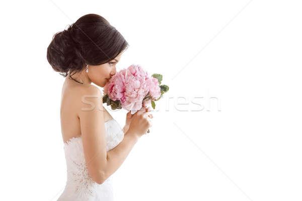 Beautiful bride with her flowers. Wedding hairstyle make-up luxury fashion dress and bouquet Stock photo © artfotodima