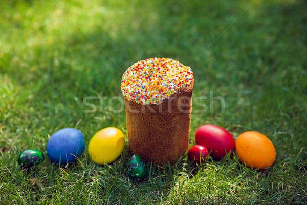 Fresh Easter cake with colorful decorative eggs Stock photo © artfotodima