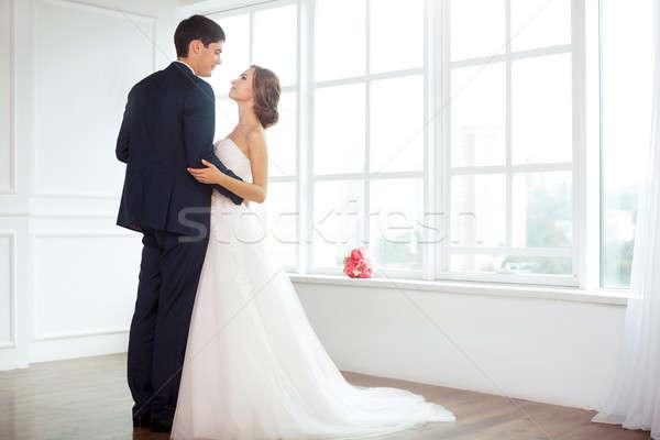 Menyasszony vőlegény fényes szoba esküvő pár Stock fotó © artfotodima