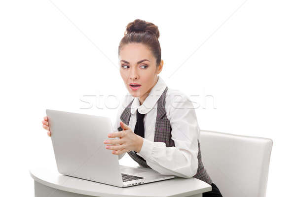 Woman hiding what she doing on laptop Stock photo © artfotodima