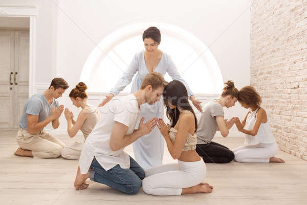 Group of people meditating indoors. Young family therapy Stock photo © artfotodima