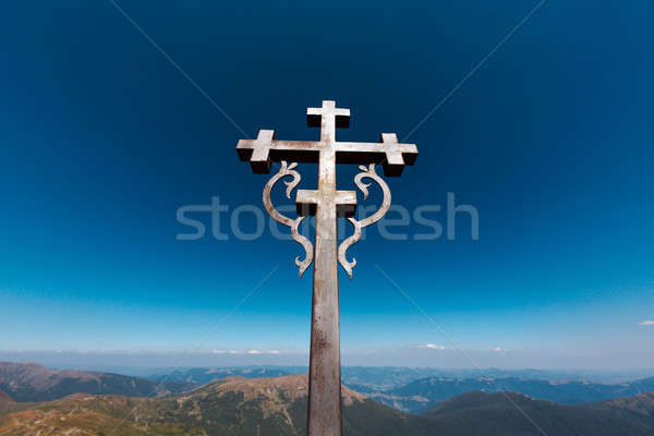 Steel cross on hill of the mountain Ukraine Stock photo © artfotodima