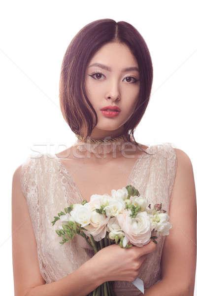 Güzel Asya kadın beyaz elbise buket çiçekler Stok fotoğraf © artfotodima