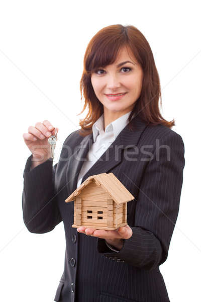 adult realtor with keys and wooden toy house,it could be the tenant too. All isolated on white backg Stock photo © artfotodima