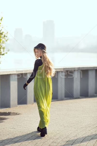 Fashion pretty young woman model in total black and green style. Street shot, bloggers outfit Stock photo © artfotodima
