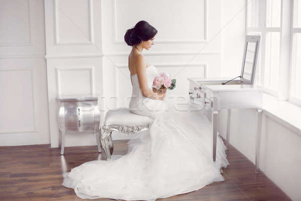 Young beautiful bride preparation at home Stock photo © artfotodima