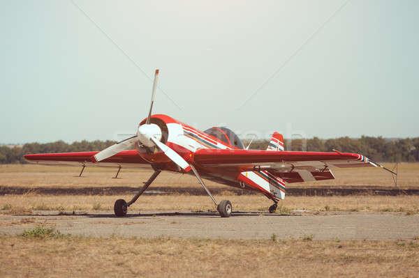 Small sport airplane at the airport. Stock photo © artfotodima