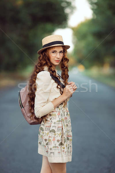 Beautiful young woman traveler portrait. Stock photo © artfotodima