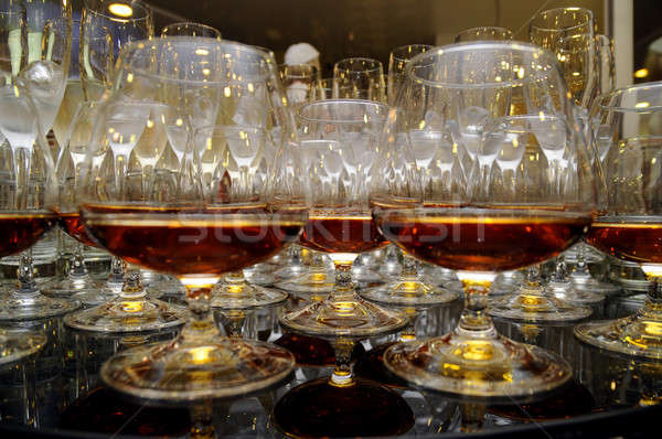 glasses of brandy at the banquet Stock photo © artfotoss