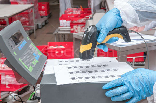 Stock photo: assignment of goods barcode at the factory