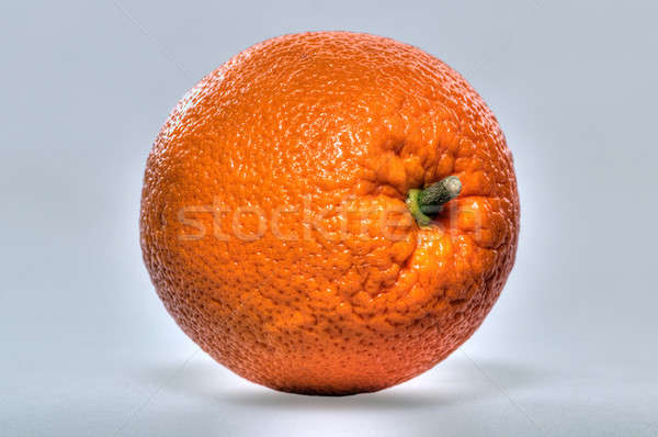 Um completo laranja isolado luz Foto stock © artfotoss