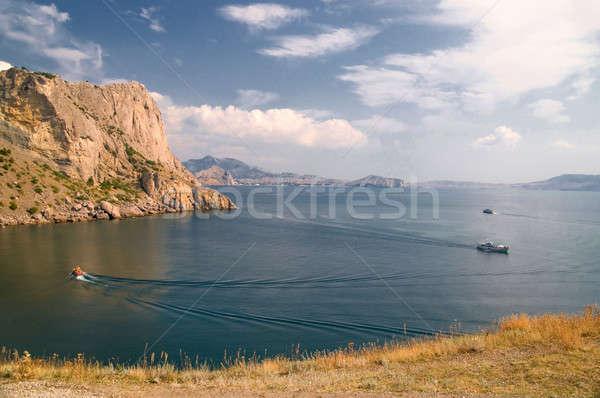 Hegyek hajók égbolt fű kék csónak Stock fotó © artfotoss