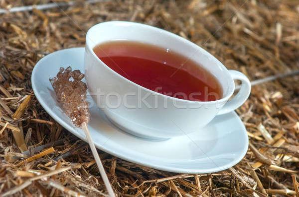 Copo chá palha delicioso textura madeira Foto stock © artfotoss