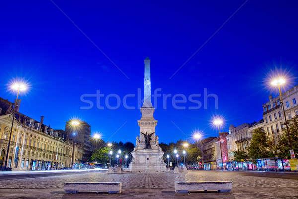 Romantic Lisbon street. Fountain at night in the center of the c Stock photo © artfotoss