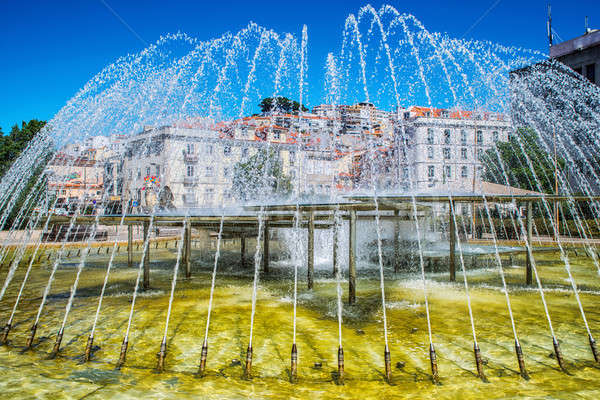Stock photo: Romantic Lisbon street. Fountain in the center of the city