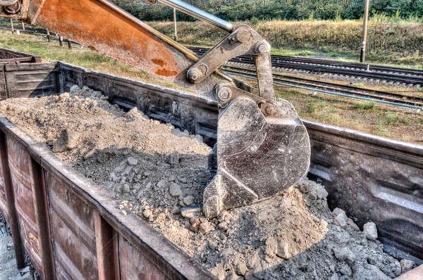 Kotrógép kerék építkezés Föld homok ipar Stock fotó © artfotoss