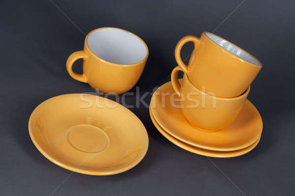 orange cup and saucer Stock photo © artfotoss