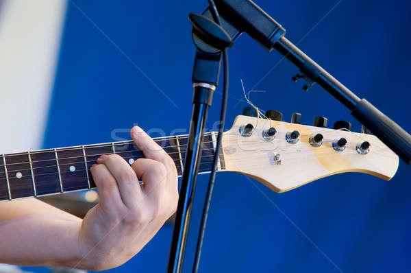 Close up on man`s hand playing guitar Stock photo © artfotoss