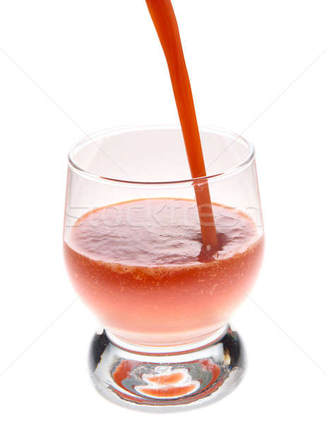 The juice is poured into a glass Stock photo © artfotoss
