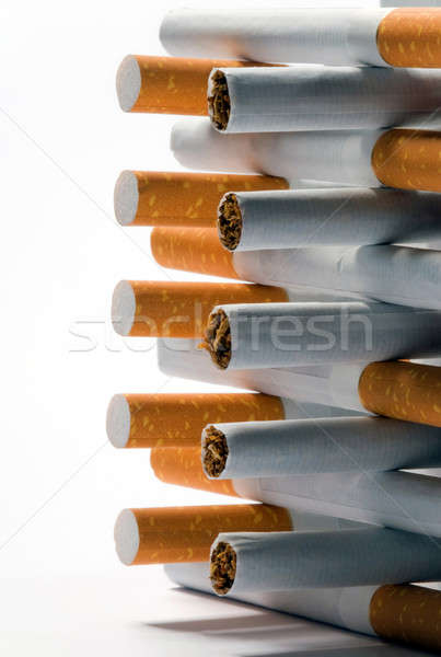Cigarettes on a white background Stock photo © artfotoss