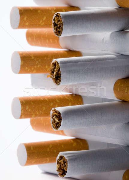 Cigaretta cigaretta fehér papír keret füst Stock fotó © artfotoss