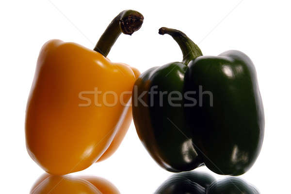 green and yellow sweet pepper on a white background Stock photo © artfotoss