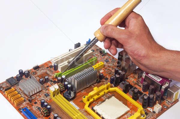 работник чипа рук рабочих пайка железной Сток-фото © artfotoss