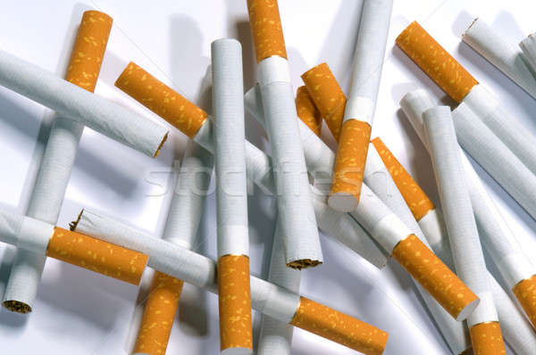 cigarettes lying on a white background Stock photo © artfotoss