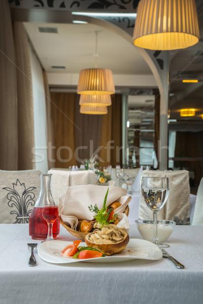 tasty dish with mushrooms in a restaurant Stock photo © artfotoss