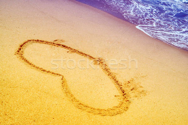 heart in sand at the beach Stock photo © artfotoss