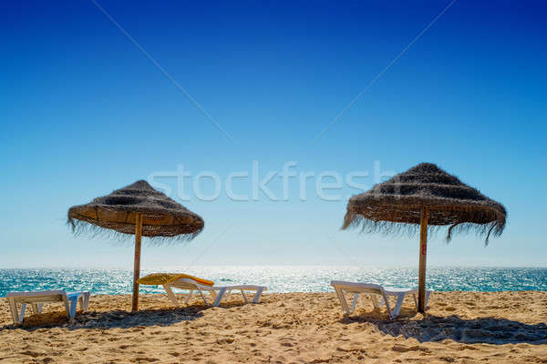 Umbrella at the shore of the Atlantic Ocean Stock photo © artfotoss