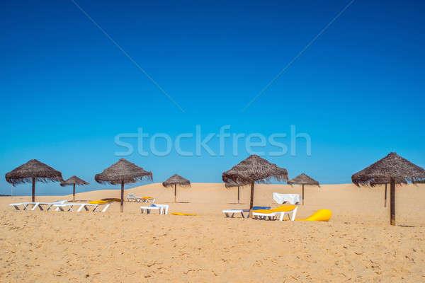 Stock photo: Umbrella at the shore of the Atlantic Ocean